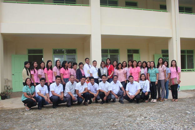 A BIG THANK YOU. Apayao Congresswoman Eleanor Bulut-Begtang (in the middle with sunglasses) acknowledged the utmost appreciation of the people of Flora as she posed with all the faculty members in front of the newly inaugurated two-storey building of Flora National High School at Flora, Apayao on January 11, 2017. Besides Congw. Begtang are: Flora Vice Mayor Jessica De San Jose (at right), Apayao SDS Dr. Amador Garcia (left of Congw) and Mr. Danilo Cudiamat, FNHS Principal. Also present is Vice Governor Remy Albano (1st row, 2nd from left). GERRIAHZON S. SEBASTIAN