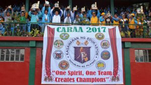 WE ARE THE CHAMPIONS. Baguio City Mayor Mauricio Domogan proudly raises the CARAA 2017 overall championship during the event's concluding rites last February 8, 2017 at the Baguio Athletic Bowl. Also in the photo are representatives from silver medalist Benguet and bronze medalist Mountain Province. (February 12, 2017) Photo by RJ Cayabyab.