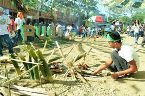 "INDIGENOUS COOKING. A young resident of Pugo, La Union participates in the 1st Tinungbo Cookfest last January 21, 2017. The local government is pushing for the revival of this indigenous cooking practices with the use of bamboo stalks through the first-ever ""Tinungbo Festival"". (January 29, 2017) Photo by JOSEPH B. MANZANO."