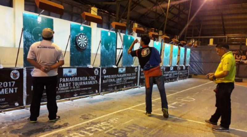 LAST TWO STANDING - Alexis Toylo, the eventual Open Singles Champion, aims the winning throw, while runner-up Ricky Mijares waits for his turn during the Panagbenga 2017 National Darts Tournament last February 17-19, 2017 at Barangay Engineer's Hill Covered Court. (February 26, 2017) Photo by AJ Magalong, UB intern.