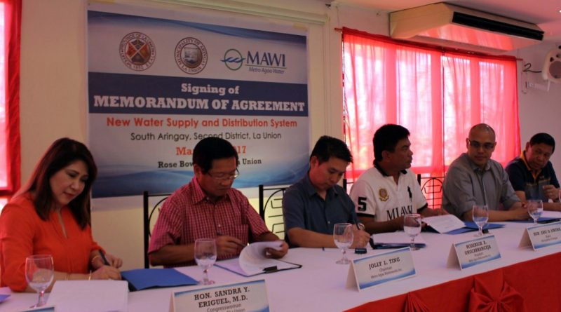 MOA SIGNING  The Metro Agoo Waterworks Inc. (MAWI) has expanded its operation to the southern part of Aringay, La Union to supply safe potable water. Photo shows the signing of the memorandum of agreement betwen MAWI and Aringay municipal government. (L-R) 2nd District Representative Sandra Eriguel, Mr Jolly Ting, MAWI chairman, Mr. Roderick Ongcarranceja, MAWI president, Aringay town Mayor Eric Sibuma, La Union Gov. Pacoy Ortega, and former Congressman Franny Eriguel. (Photo by JUN ELIAS)