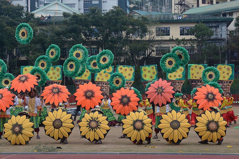 Performers from Pugo, La Union toss the giant flowers props during the filed demonstrationin 22nd edition of the Baguio Flower Festival or the Panagbenga 2017 Grand Street Dancing in Baguio City during the weekend. RMC PIA-CAR