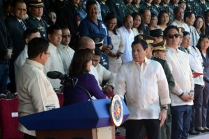 President Rodrigo Duterte greets Vice President Leni Robredo during the graduation rites at the PMA Fort Del Pilar in Baguio City last March 19, 2017. (March 24, 2017) REDJIE MELVIC CAWIS, PIA-CAR.