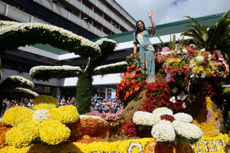 Reigning Miss International Kylie Versoza, a Baguio girl, waves to the crowd as she parades aboard the Pepsi Cola float during the recent Panagbenga Grand Float competition. Photo by RMC PIA-CAR.