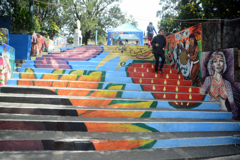 The G.I.N.T.O (Guild of Integrated Talents) Baguio, group of local artists in Baguio City turned the Post Office Park into another lively artwork inspired by the rich culture and tradition of the Baguio City, Benguet and the Cordillera region including the Panagbenga festival. The artwork was unveiled in time for the Panagbenga festivities. Here, a father and daughter enjoys photo opportunities with the colourful artwork as background. (March 5, 2017) REDJIE MELVIC CAWIS, PIA-CAR.