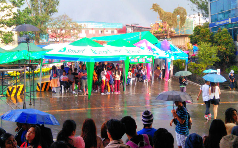 RAIN ON PARADE. Several years back, it was so difficult to see a raindrop from the dry January to March. Now, downpours during Panagbenga celebrations are consistently becoming a common sight. The 2017 Session Road in Bloom was not spared by this February 28 quick shower despite the sun appearing in the sky, Photo by ARMANDO BOLISLIS