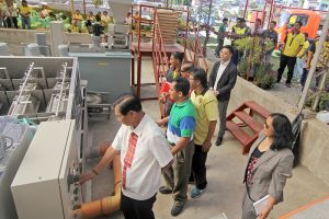 CITY'S CLEAN WATER INITIATIVE- Mayor Mauricio Domogan and AMCON Inc, Japan overseas sales representative Yusuke Suzuki startupthe P17 million Japanese- made Sludge Dewatering Press Units to separate sludge and water from the sewer treatment plant at North Sanitary Camp as part of the city's clean water initiative program. Present during the occasion are City Environment and Parks Development Officer Cordelia Lacsamana, Councilors Beny Bomogao and Leandro Yangot Jr, City Administrator Carlos Canilao newly appointed City Human Resource and Management Officer Atty. Agustin Laban Jr.(April 30, 2017) by Bong Cayayab