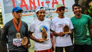WE WILL ROCK YOU. The 2017 Lang-ay Run Men's 42k Champs display their hardware. From left: Romando Cumahling, 2nd runner up; Thomas Combisen, Champion; Ronell Vallero, 1st runner up; and Meldwyn Bauding, Race Director. (April 15, 2017) JENNIFER C. GUEVARRA, photo by: WILFREDO DAOAS, JR.
