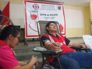 MINE BLOOD - Lawyer Rodolfo Bondad, assistant manager at the Legal Department of Philex Mining Corp.'s Padcal operations, is having his blood drawn by a Red Cross volunteer nurse at the offices of AM radio, dzWT, in the Bishop's House Compound, Baguio City, as he takes part in a bloodletting during the 52nd Founding Anniversary celebration of the Mt. Province Broadcasting Corp. (April 23, 2017) MPBC
