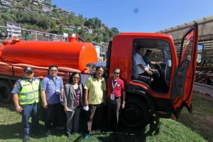 NEW VACUUM TRUCK - Mayor Mauricio Domogan tries out the newly purchase P6 million Isuzu Vacuum Truck during simple rites as partof the City/s Clean water Initiative being undertaken by the City Environmet and parks management Office headed by Cordelia Lacsamana. With Mayor Domogan are City Environment and Parks Development Officer Cordelia Lacsamana, Councilors Beny Bomogao and Leandro Yangot Jr, City Administrator Carlos Canilao newly appointed City Human Resource and Management Officer Atty. Agustin Laban Jr. (April 30, 2017) by Bong Cayayab