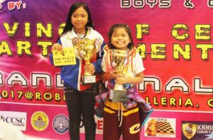 MIND BOARD WIZARDS. Mhage Gerriahlou Sebastian of Flora, Apayao (left), Mecel Angela Gadut of Candon City and Brylle Gever Vinluan (not in photo) will be competing in the upcoming ASEAN + Age Group Chess Championship in Vietnamas theymade it toTop 3 of the 2017 Grand Finals of the National Age Group Chess Championship held in Cebu City last May2-10, 2017. (May 14, 2017) By: GERRIAHZON SEBASTIAN